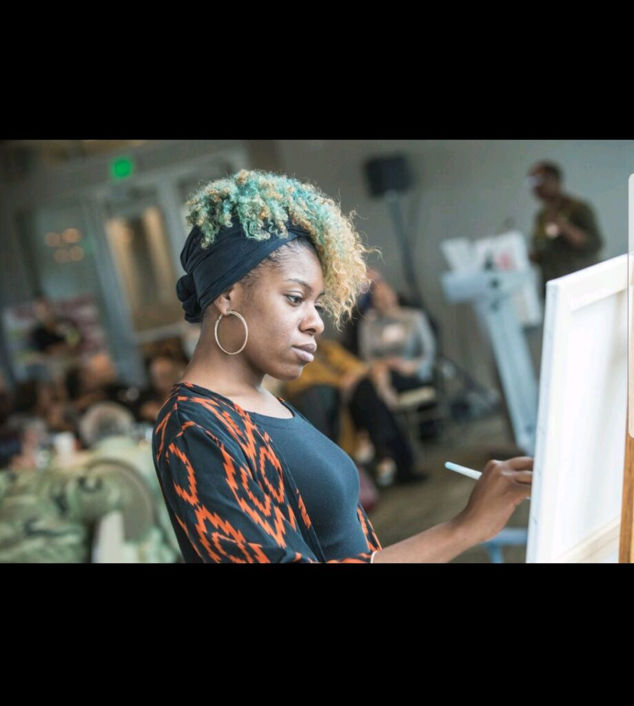 black woman artist Lavonne Barfield painting live