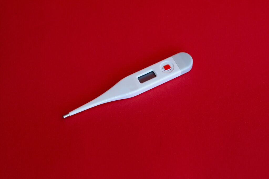 thermometer sitting on a red backdrop