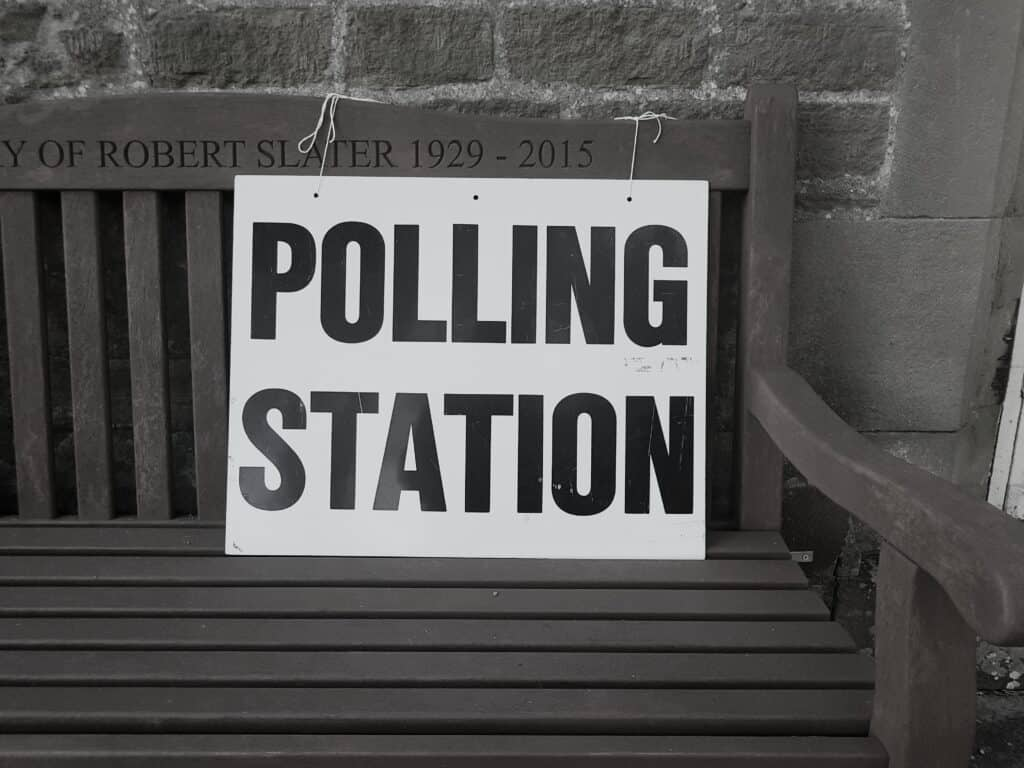 black and white polling station sign