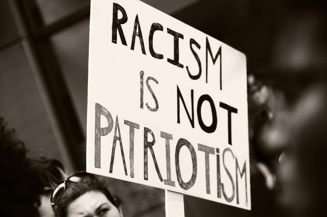 photo of protest sign racism is not patriotism