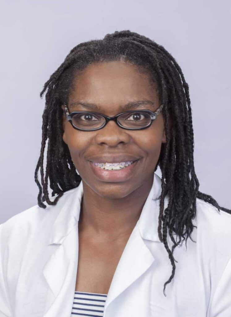 black american nurse in white coate