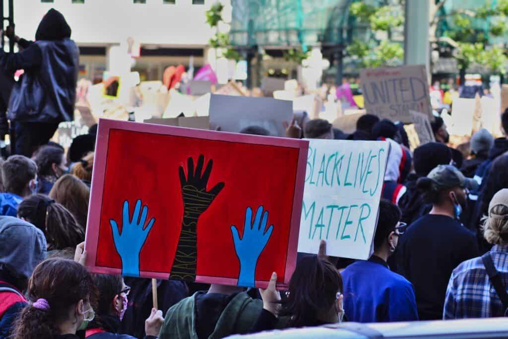 red Black lives matter sign at a Black lives matter protest