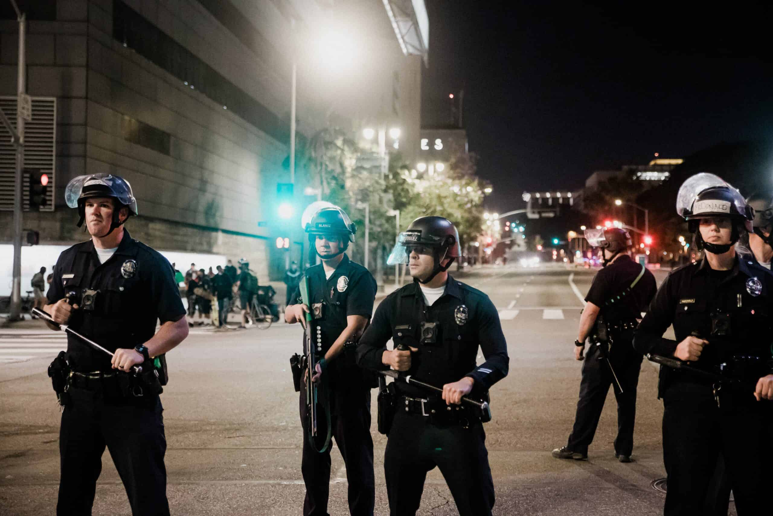 white police officers in riot gear