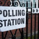 black letters that spell out polling station