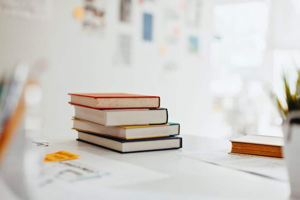 a stack Books on desk in modern design office