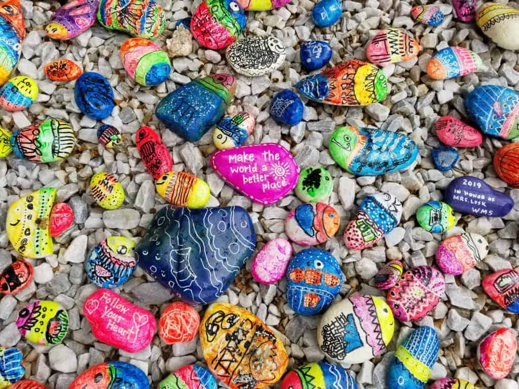 close up photos on different color rocks in the sand